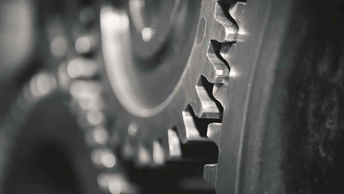 Close-up of gears in dark steel gray